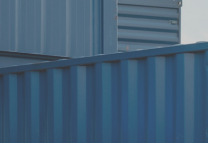 cropped view of blue shipping containers